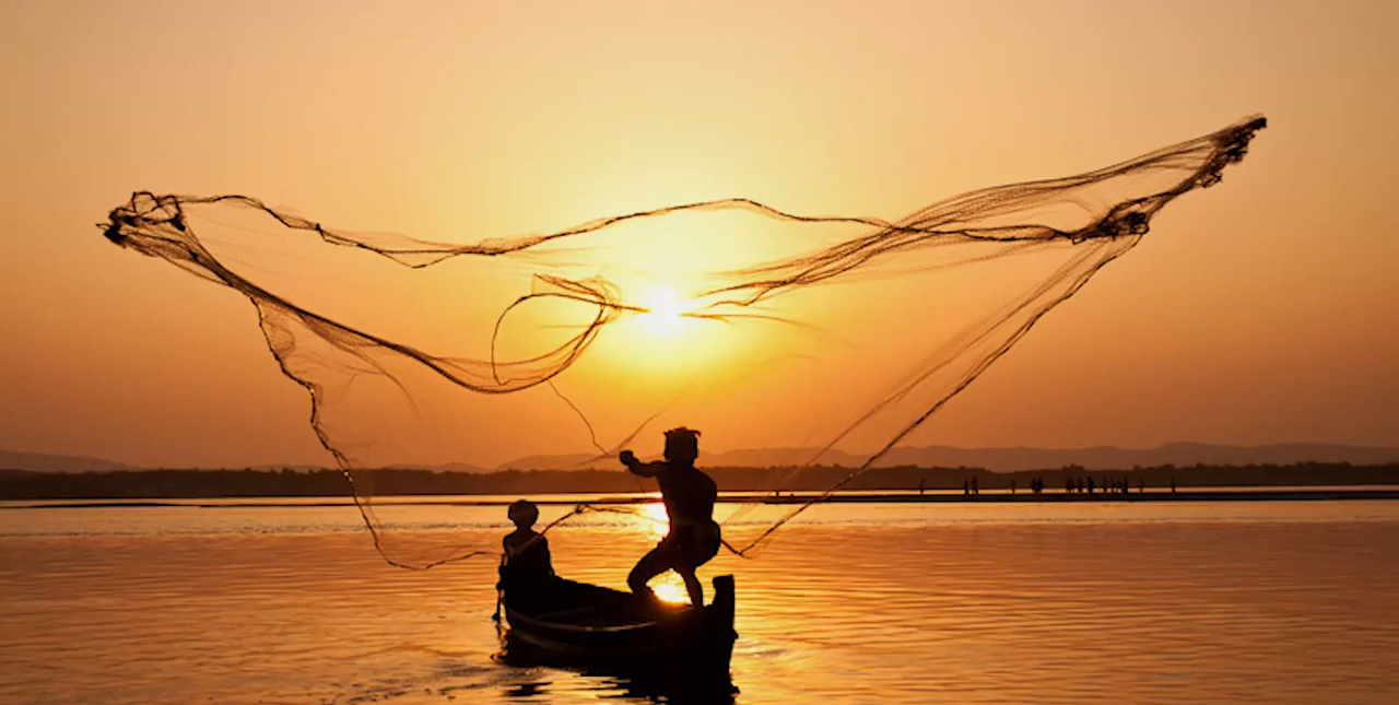 Photo of Fishermen Casting Net